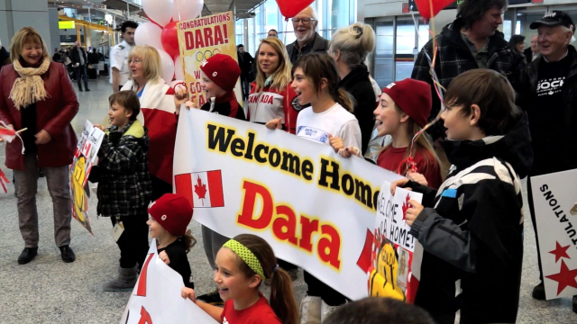 Fans & family welcome home Olympians