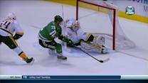Erik Cole squeezes it past Carter Hutton