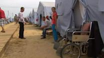 Refugees seek shelter in Russia as Ukraine forces tighten grip on rebels