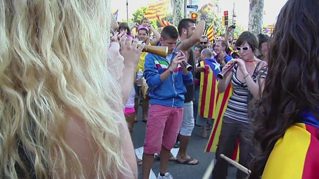 Catalans mass for independence, warn of 'freedom' bid