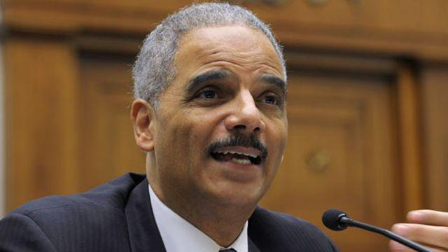 Holder back in hot seat