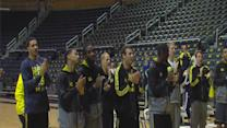 University of Michigan basketball team returns home