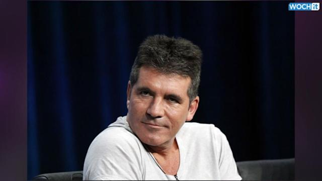 Simon Cowell Smiles Following The Birth Of Son Eric--See A Pic Of The New Dad!