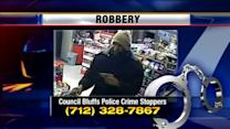 Robber hits clerk during robbery