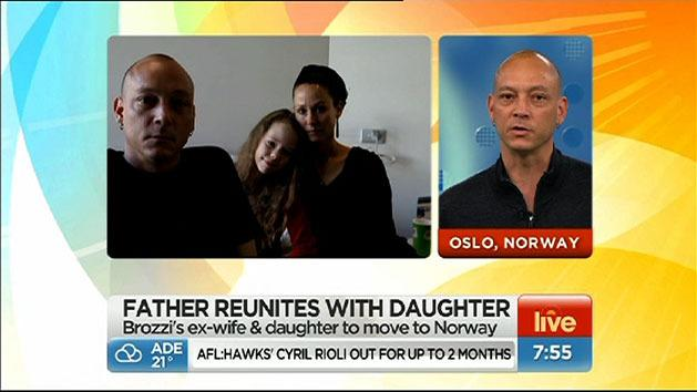 Father reunites with family