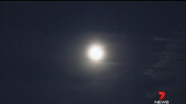 Clouds and rain hide Supermoon