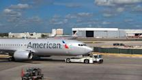 Feds sue to block US Airways, American Airlines merger