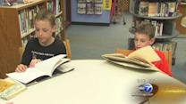 Wilmette twins break Guinness record with 24 sets in 5th grade class