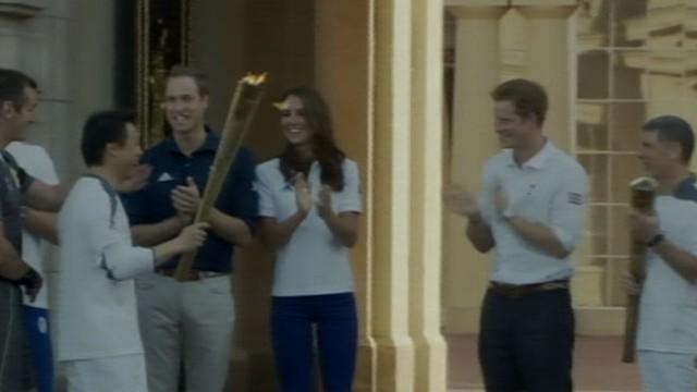 Will and Kate Welcome Olympic Torch to Buckingham Palace