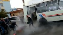 Raw: Hot-Water Pipe Bursts Under Bus in Russia