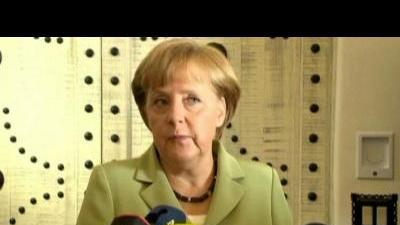 Merkel: Greece must stick to commitments.