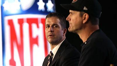 Harbaugh Brothers Share Same Stage, Same Focus