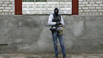 Armed men take over police station in Ukraine's Slaviansk