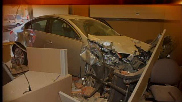 Noon: Car goes through Strongsville building