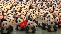 Panda sculptures charm travelers at a Hong Kong airport