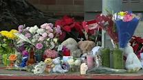 High school students mourning death of classmate