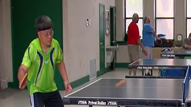 Cayden tries his best at table tennis