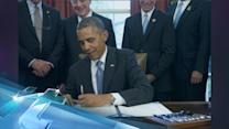Obama signs student loan deal, says job isn't done