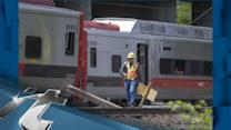Damaged Trains Being Removed From Wreck Site