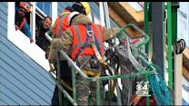 Workers Stuck In Cherry Picker After Hitting High Voltage Wires In Everett