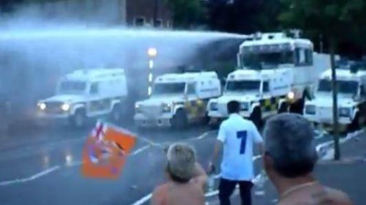 Police turn water cannon on Belfast rioters
