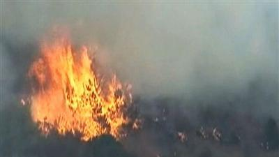 Vicious wildfires spread to Colo. tourist spots