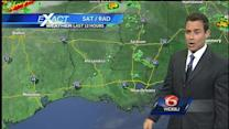 Hot with isolated to scattered showers and storms