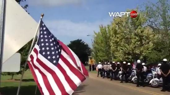 Firefighters, police attend funeral