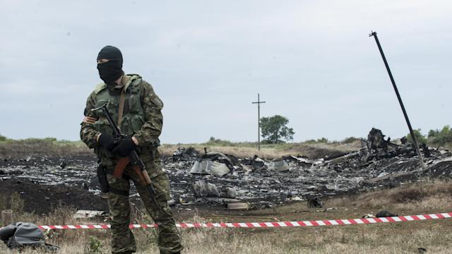 Ukraine says Russia helping destroy crash evidence