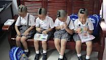 Mom shaves ID numbers on quadruplets' heads