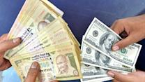 Rupee pares early gains; down 14 paise vs USD