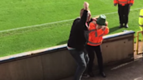 Football Crowd Plays With a Plant Pot