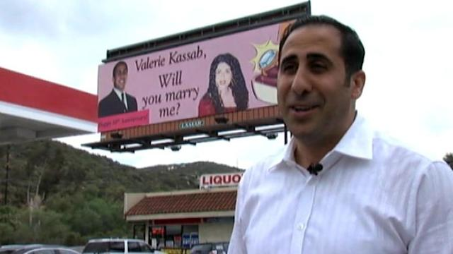 Husband Revises Proposal Billboard for Anniversary Surprise