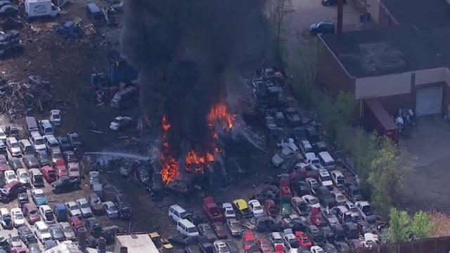 Detroit Fire fighters on scene of large junkyard fire