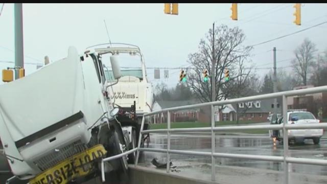 IMPD officer injured in crash with semi