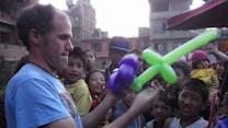 American Clown Brings Smiles to Nepali Children With Balloon Animals