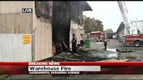 Firefighter Falls While Ventilating Roof During Warehouse Fire