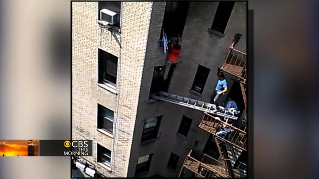 Watch: Harrowing escape from NYC apartment window