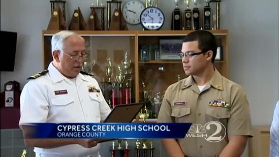 High school student honored for saving woman