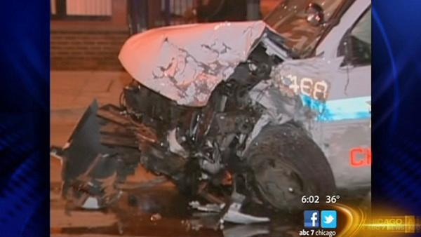 Car crashes into police SUV, killing driver and injuring 4