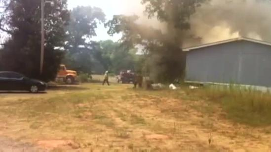 Raw video: Structure burns near Highway 9 in Norman