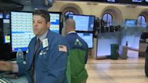 Wall St. shakes off economic data