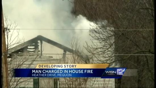 Man charged with setting own house on fire