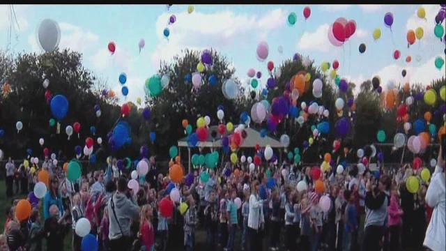 Students release balloons to honor friend who died of cancer