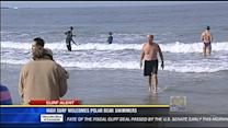 High surf welcomes polar bear swimmers