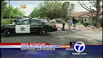 SWAT team tries to get man out of home