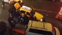 New York City Police Lift Taxi Off Man