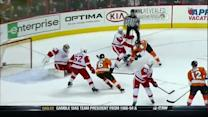 Adam Hall chips a backhander by Gustavsson