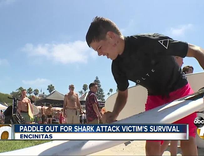 Community paddles out for boy who survived 2018 Shark attack