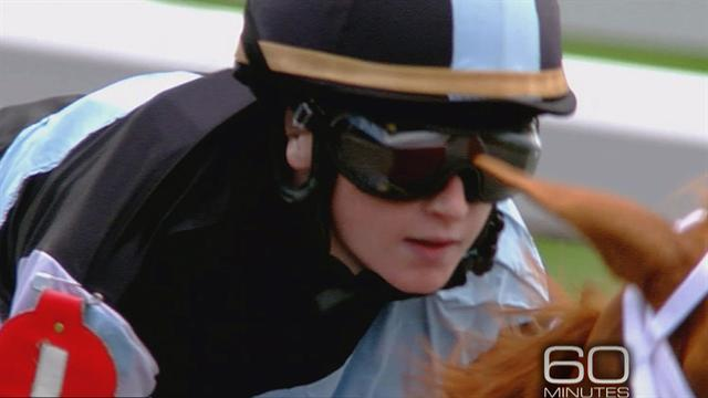 Female jockey leads horse racing pack